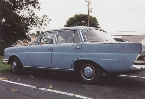 side view of a baby blue 1966 230s mercedes benz